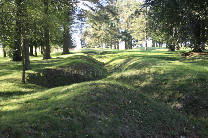 WWI trenches. All overgrown with grass are a memorial to those who fought and died in Belgium and France Europe during the Great War of 1914-18 stock photos