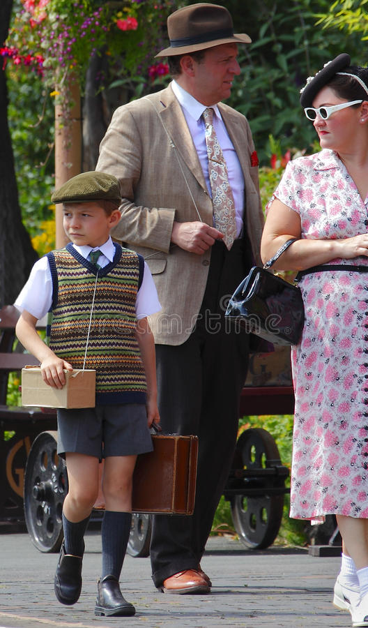 WWII English war family. With child being sent as a refugee in 1940's clothes in a reenactment on the 3rd June 2011 at Bridgnorth, Shropshire, England royalty free stock images