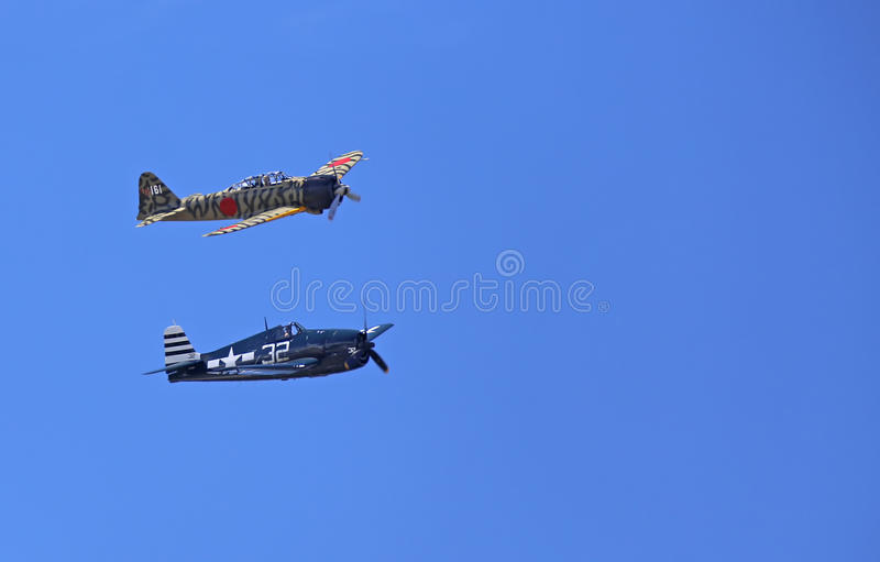 WWII Planes. EVERETT - JUNE 29: A restored World War 2 Grumman F6F-5 Hellcat and a Mitsubishi A6M3-22 Reisen Zero was seeing flying in the skies over Everett royalty free stock photography