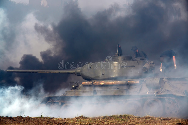 WWII tank, some smoke. stock photography