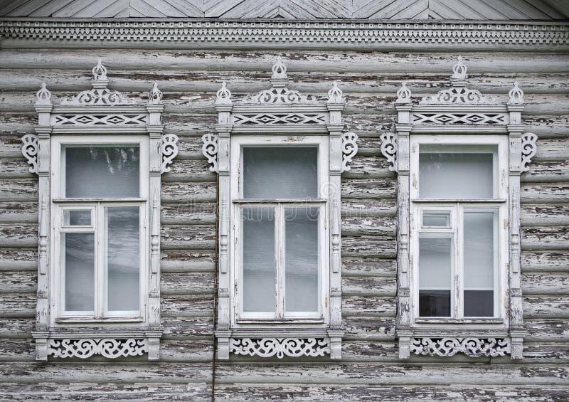 Windows. Wooden architecture. Craftsmanship. Old masters. Wooden Windows. Wooden architecture. Craftsmanship. Old masters of Russia. Carved shutters stock images