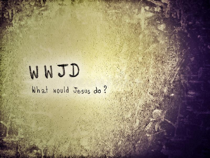 WWJD is stand for What would Jesus do. It is a personal motto for a Christian who used the phrase as a reminder of their belief to act in a manner that would stock photography