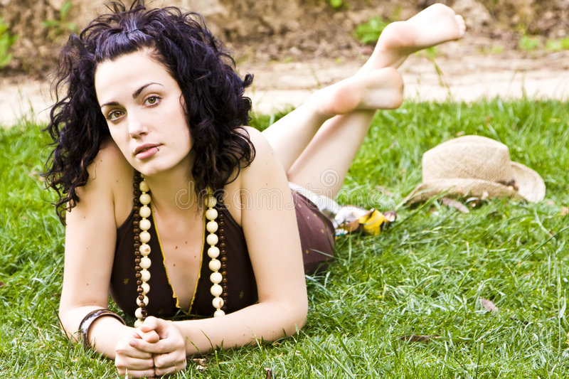 Download WWoman on grass stock photo. Image of curly, pensive, copyspace - 5824990