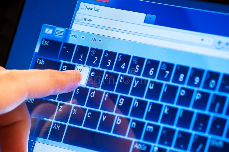 Www on touch screen. Typing www on touch screen virtual keyboard stock photo