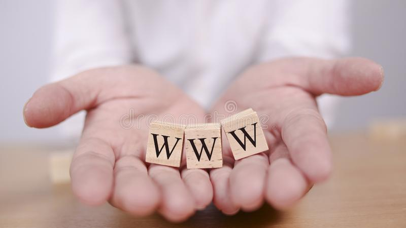 WWW World Wide Web Internet Concept. WWW World Wide Web in wooden words letter, internet business typography quotes concept background letters network symbol stock photo