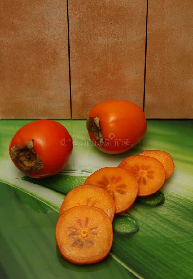 Wyśmienicie owoc mięsisty persimmon jaskrawa pomarańcze fotografia royalty free