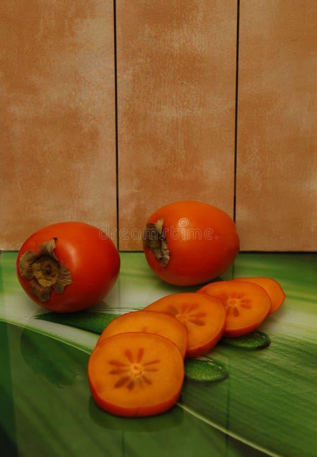 Wyśmienicie owoc mięsisty persimmon jaskrawa pomarańcze zdjęcie stock