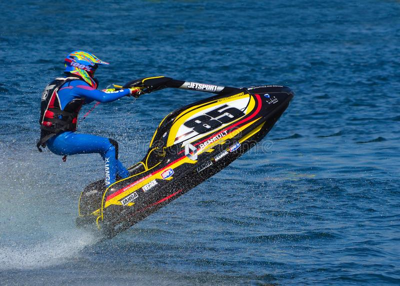 Jet Ski racer going over jump at speed. royalty free stock photography