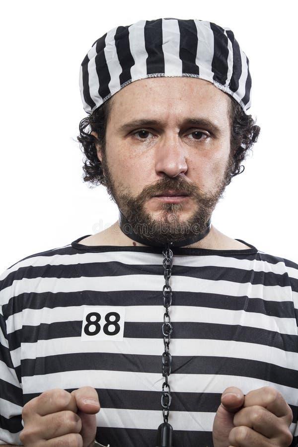 Wychwytany, jeden caucasian mężczyzna więźnia przestępco z łańcuszkową piłką, i obraz stock