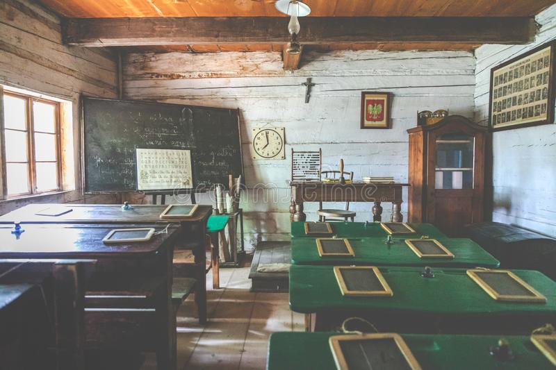 WYGIEŁZÓW, POLAND - JUNE 28, 2019: Rural school interior of wooden cottage in heritage park. Open-air museum Nadwiślański royalty free stock photography