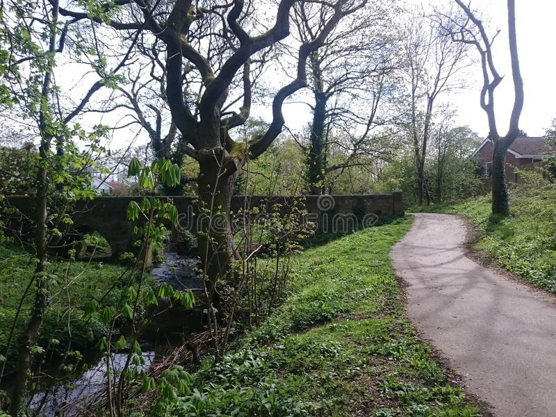 Wykebeck Way though the trees in Leeds West Yorkshire England. Europe stock images