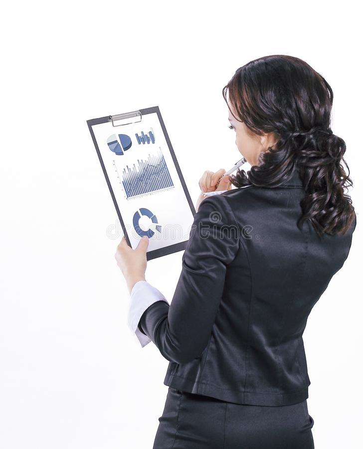 Wykonawcza biznesowa kobieta sprawdza pieni??nych dokumenty Odizolowywaj?cy na bielu fotografia royalty free