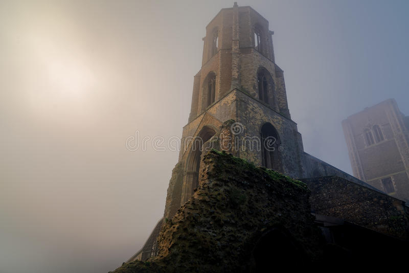 Wymondham Abbey in Winter TimeFog. The Twin Towers of Wymondham Abbey in Norfolk, UK pictured in early morning winter fog stock photography