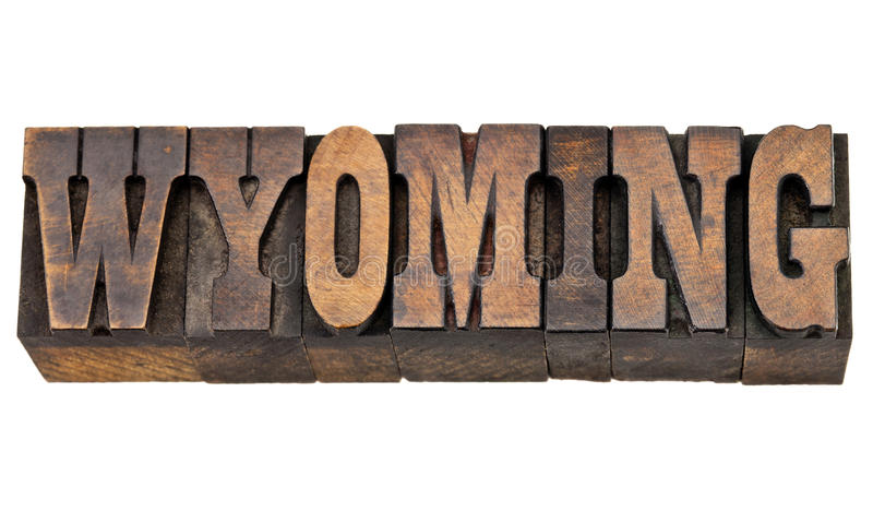 Wyoming state name in letterpress wood type. Wyoming - isolated word in vintage letterpress wood type - French Clarendon font popular in western movies and royalty free stock images