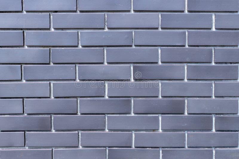 Wyrównuje deseniowego szarość koloru ściany z cegieł nową powierzchnię zdjęcia stock