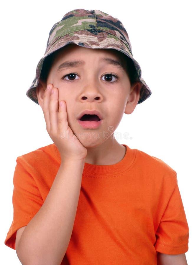 wyrażeniowy twarzy ręki dzieciak szokujący zdjęcie stock