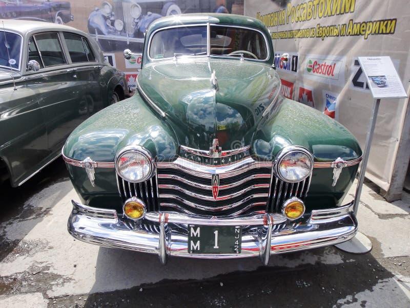 Wystawa retro samochody Zielony samochodowy ?Oldsmobile ?, rok manufaktura 1941, pojemno?? 115 HP, usa Stary Ameryka?ski gatunek fotografia stock