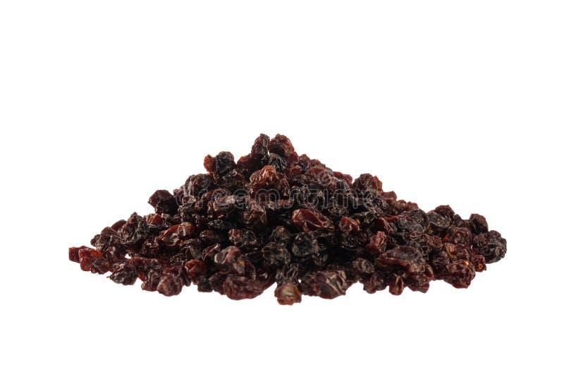 Wysuszony czarnych wiśni rozsypisko odizolowywający na bielu obrazy stock