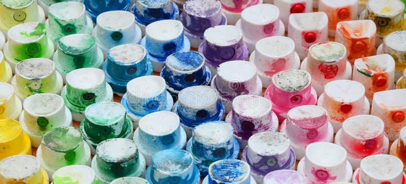 Wzór od wiele nozzles od farby natryskownicy dla rysunkowych graffiti, mażącej w różnych kolory Plastikowe nakrętki są arra obrazy royalty free