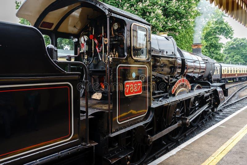 Wznawiająca Brytyjska parowa lokomotywa 7827 «Lydham rezydencja ziemska «, Paignton, Devon, Anglia, Zjednoczone Królestwo, Maj 24 obraz royalty free