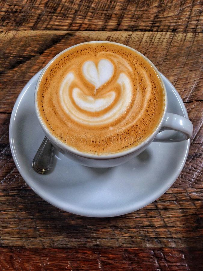 Xícara de café do Latte imagem de stock