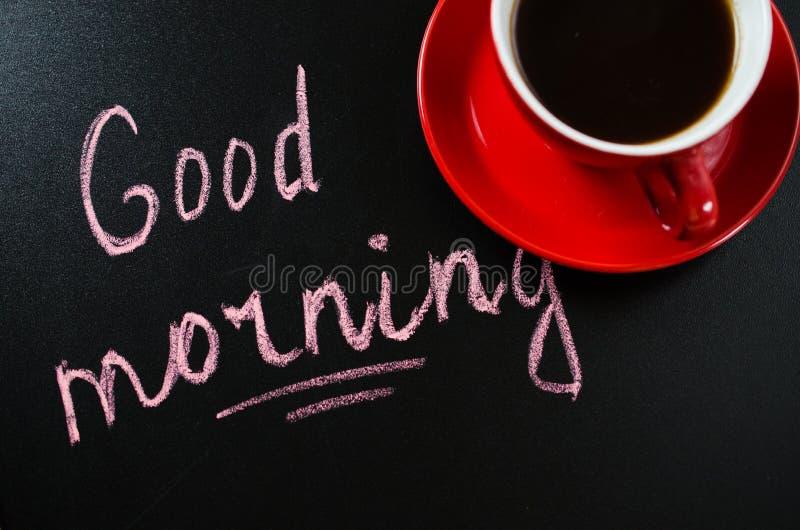 Xícara de café e o bom dia da inscrição imagens de stock royalty free