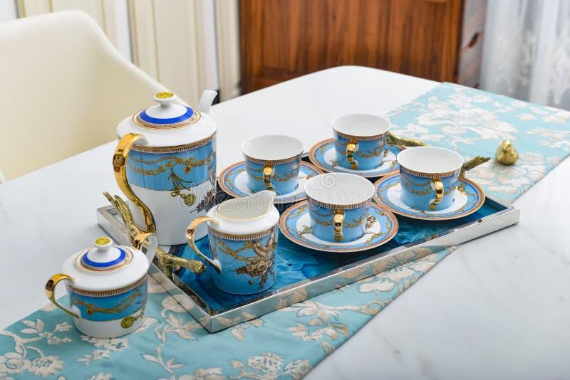 Xícara de chá do bule do copo de café do potenciômetro do café da sala de Dinning imagem de stock