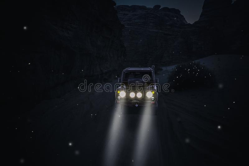4x4 car in the desert with lights on vector illustration