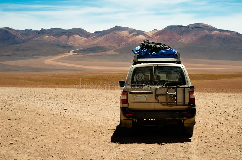 Car in the desert of Bolivia. 4x4 Car in the desert of Uyuni in Bolivia jeep terrain vehicle sand south america summer hot landscape mountain arid no road stock image