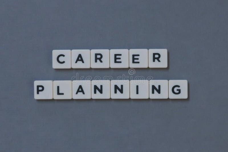 ' Carrière Planning ' woord van vierkant brievenwoord wordt gemaakt op grijze achtergrond die stock afbeeldingen