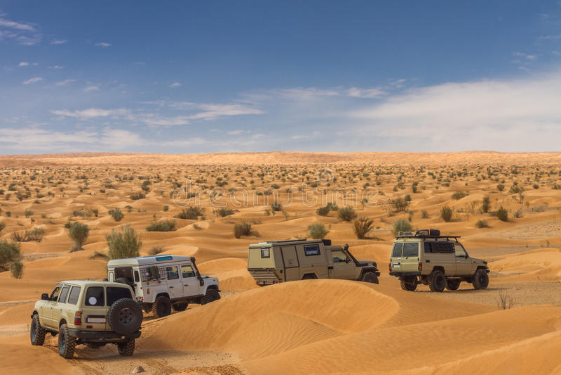 4x4 cars driving through desert. All terrain cars driving through the tunesian desert royalty free stock images