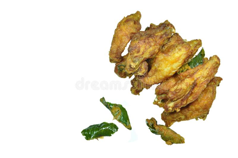 Crispy fried chicken wing with lemon grass on white background royalty free stock image