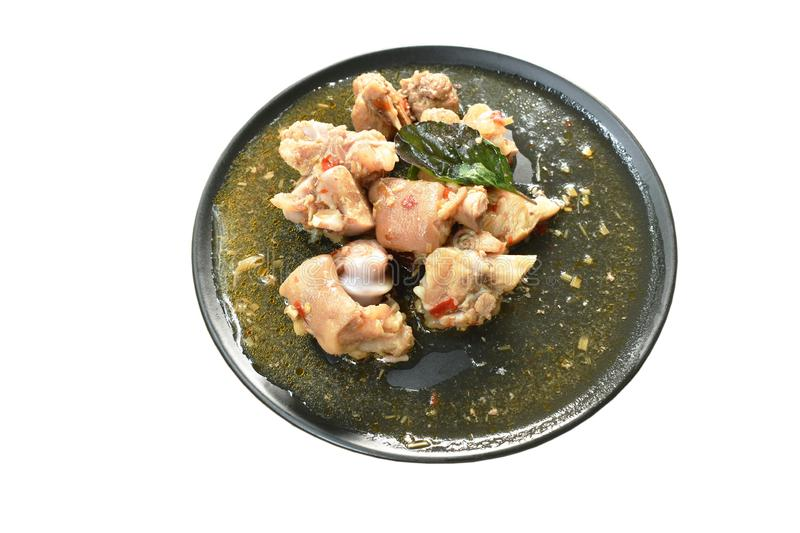 Spicy stir fried pork leg with basil on plate stock images