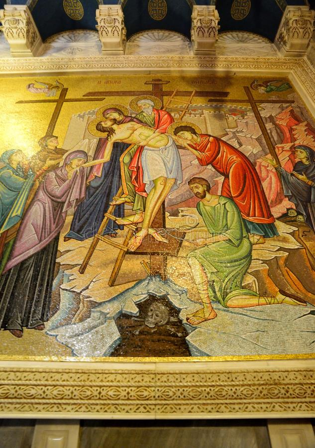 Descending Jesus from the cross. Mosaic stock photos