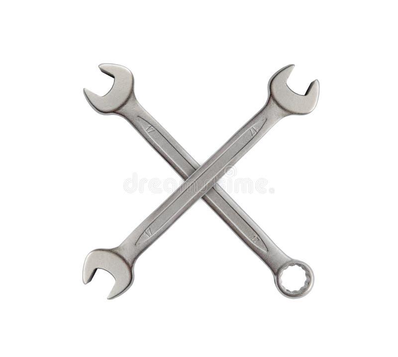 X feito da chave da ferramenta do metal da prata do mecânico para o reparo isolada imagens de stock