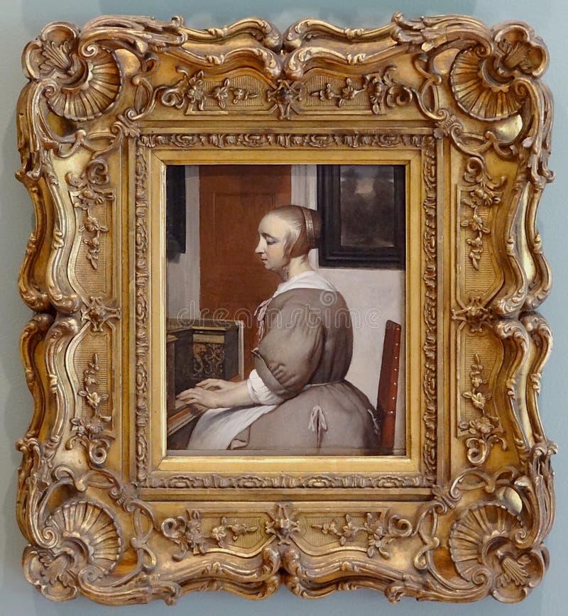 """""""Femme au virginal"""", Gabriel Metsu, vers 1662. royalty free stock image"""