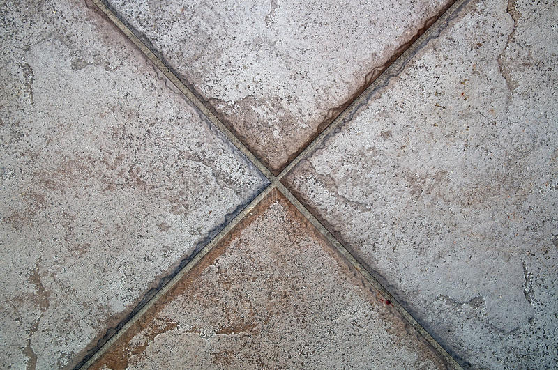 X formed by floor tiles stock image