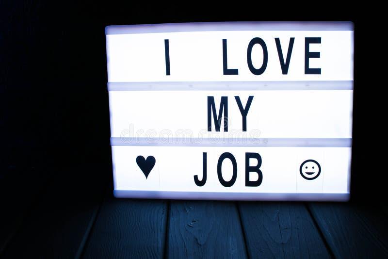 ' Ich liebe mein job' Text im lightbox lizenzfreie stockfotos