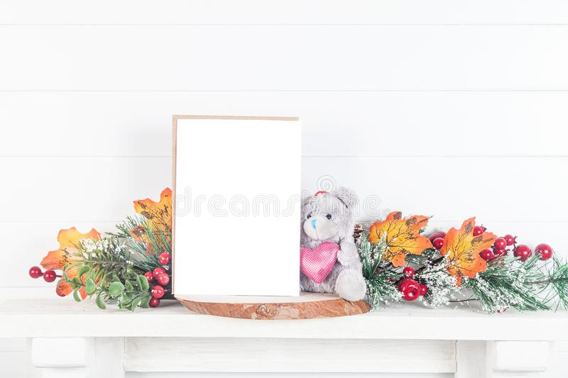5x7 invitation mockup on a mantelpiece with autumn leaves royalty free stock photos