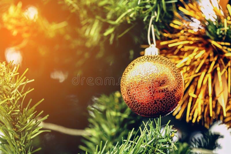 X`mas ball decoration on christmas tree royalty free stock images