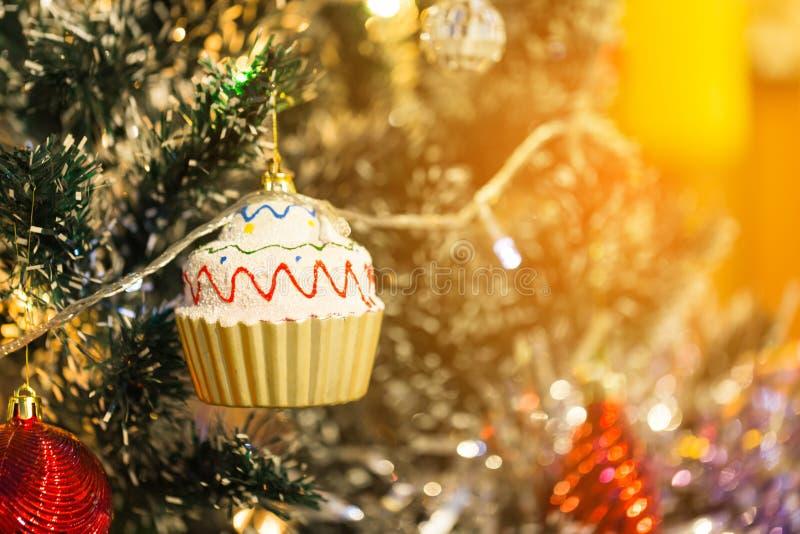 X`mas cup cake decoration on christmas tree royalty free stock photos
