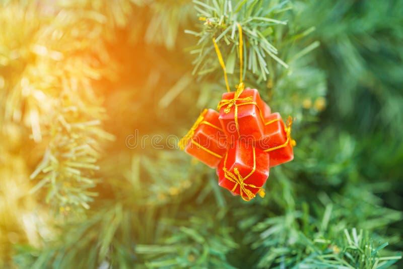 X`mas Gift Box decoration on christmas tree royalty free stock photo