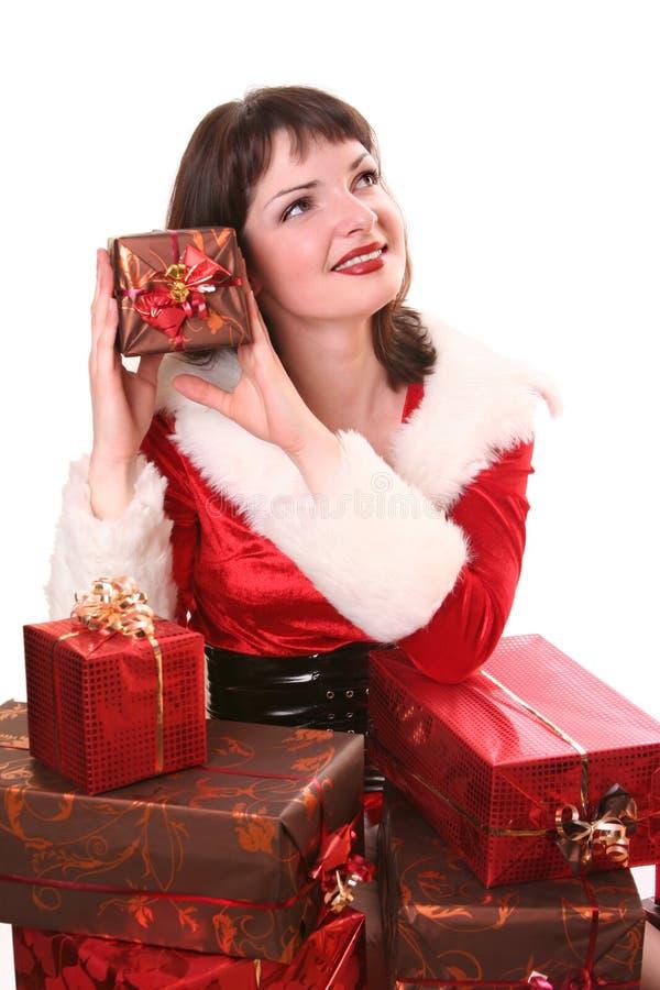 X-mas presents. Young Santa-girl with presents stock photo