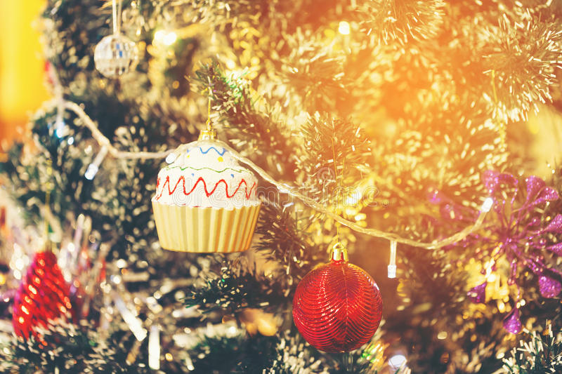 X`mas Red ball and cup cake decoration on christmas tree royalty free stock photos