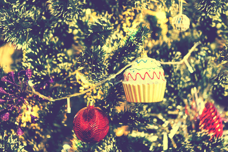 X`mas Red ball and cup cake decoration on christmas tree stock image