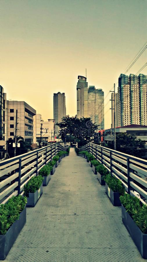 When the path reveals itself, follow it. An urban steel overpass located in Kapitolyo pasig, Philippines. & x22;When the path reveals itself, follow it.& x22 royalty free stock image