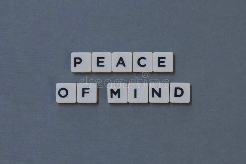 & x27; Peace Of Mind & x27; word made of square letter word on grey background royalty free stock images