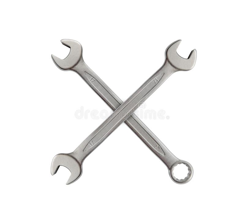 X som göras av den isolerade skiftnyckeln för hjälpmedel för mekanikersilvermetall för reparation arkivbilder