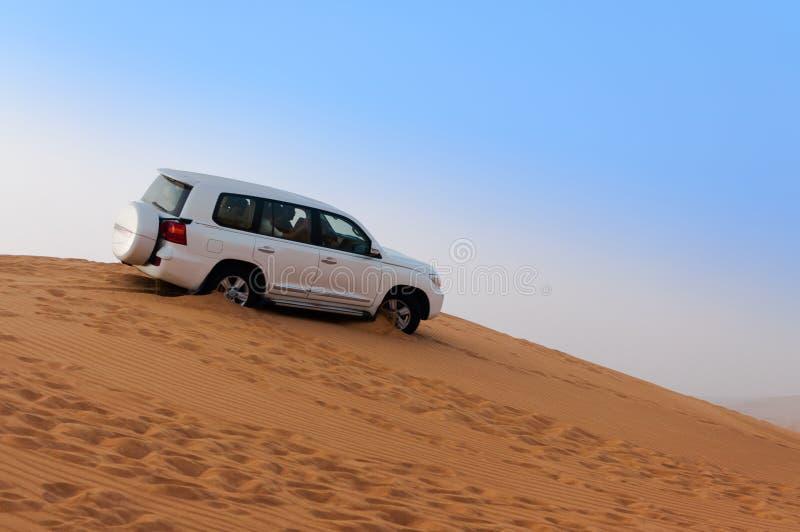 Offroad Desert Safari - Dune bashing with 4x4 vehicle in the Arabian sand dunes, Dubai, UAE. 4x4 SUV dune bashing in the Arabian desert close to Dubai, UAE stock photos
