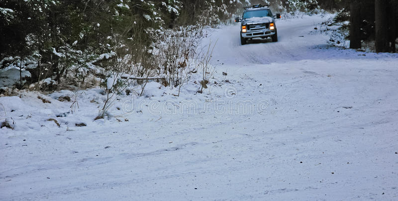 4x4 truck drifting on winter snow road in forest royalty free stock images